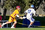 Rancho Santa Margarita, CA 04/30/10 - Connor Ebner (Santa Margarita #33) and Cobi Emery (Torrey Pines #10) in action during the Rancho Santa Margarita CHS-Torrey Pines boys varsity lacrosse game.