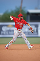 Shortstop Jose Guzman (16), of the AZL Angels, throws to first base during an Arizona League game against the AZL Padres 1 on August 5, 2019 at Tempe Diablo Stadium in Tempe, Arizona. AZL Padres 1 defeated the AZL Angels 5-0. (Zachary Lucy/Four Seam Images)