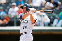 Charlotte Knights designated hitter Brent Morel (26) follows through on his swing against the Gwinnett Braves at Knights Stadium on July 28, 2013 in Fort Mill, South Carolina.  The Knights defeated the Braves 6-1.  (Brian Westerholt/Four Seam Images)