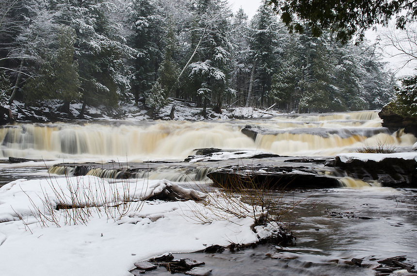 A winter view of Manido Falls on the Presque Isle River in the Porcupine Mountains.