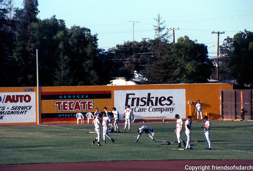 "Ballparks: Stockton, CA. Billy Hebert Field, pre-game. Stockton colors blue and yellow, but in red, their ""Mudville Nine"" uniforms."
