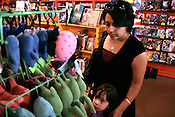 May 15, 2009. Chapel Hill, NC..Annu Sood and Ananya Cox, 4, browse the stuffed animals offered at the Chapel Hill Comics amongst a wide array of books and comic books.