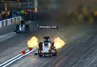 Mar 28, 2014; Las Vegas, NV, USA; NHRA top fuel dragster driver Terry McMillen during qualifying for the Summitracing.com Nationals at The Strip at Las Vegas Motor Speedway. Mandatory Credit: Mark J. Rebilas-