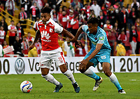 BOGOTA - COLOMBIA - 25 - 02 - 2018: Wilson Morelo (Izq.) jugador de Independiente Santa Fe, disputa el balón con Juan Camilo Roa (Der.) jugador de Jaguares F. C., durante partido de la fecha 5 entre Independiente Santa Fe y Jaguares F. C., por la Liga Aguila I 2018, en el estadio Nemesio Camacho El Campin de la ciudad de Bogota. / Wilson Morelo (L) player of Independiente Santa Fe struggle for the ball with Juan Camilo Roa (Der.) jugador de Jaguares F. C., during a match of the 5th date between Independiente Santa Fe and Jaguares F. C., for the Liga Aguila I 2018 at the Nemesio Camacho El Campin Stadium in Bogota city, Photo: VizzorImage / Luis Ramirez / Staff.