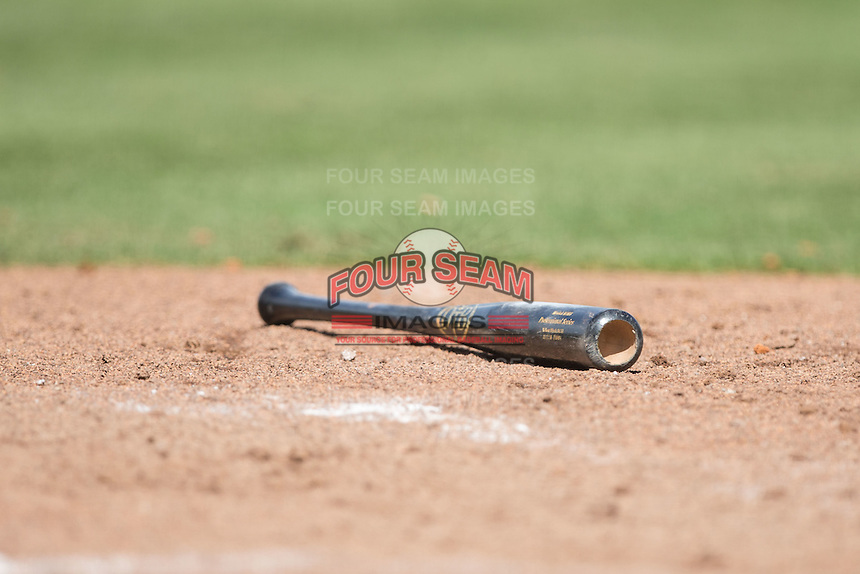 A baseball bat lies in the dirt near home plate during the Carolina League game between the Wilmington Blue Rocks and the Winston-Salem Dash at BB&T Ballpark on June 5, 2016 in Winston-Salem, North Carolina.  The Dash defeated the Blue Rocks 4-0.  (Brian Westerholt/Four Seam Images)