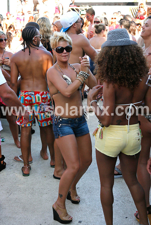 """**ALL ROUND PICTURES FROM SOLARPIX.COM**                                 **WORLDWIDE SYNDICATION RIGHTS**                   .""""Lovejuice""""  pool party at Buddha Beach in Puerto Banus in Marbella, on Saturday.                                                                           This pic:    Kerry Katona                                                                                       JOB REF:    13449    AB1       DATE:   29.05.11                                                          **MUST CREDIT SOLARPIX.COM OR DOUBLE FEE WILL BE CHARGED**                                                                        **MUST NOTIFY SOLARPIX OF ONLINE USAGE**                 **CALL US ON: +34 952 811 768 or LOW RATE FROM UK 0844 617 7637**"""