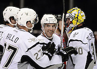 San Antonio Rampage players Mike Mottau, center, and Greg Rallo, left, congratulate Rampage goaltender Scott Clemmensen on the win after an AHL hockey game against the Rockford IceHogs, Saturday, Oct. 5, 2013, in San Antonio. San Antonio won 3-1. (Darren Abate/M3D14.com)