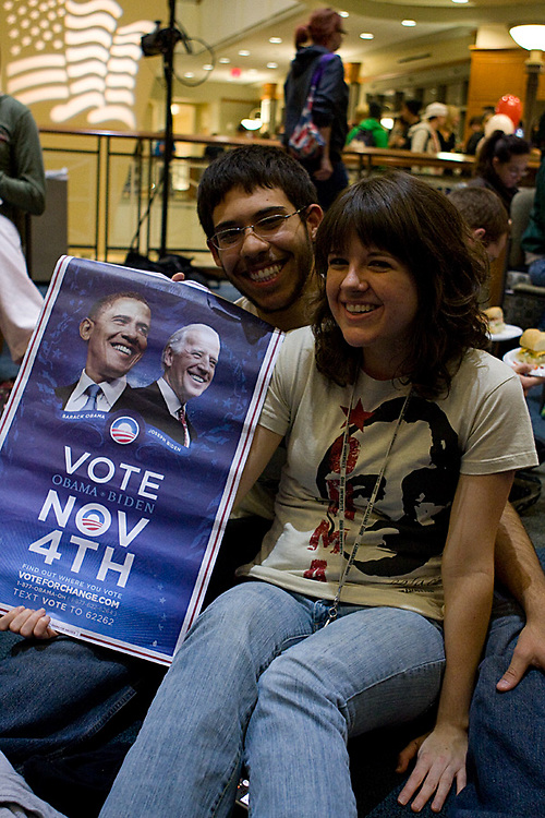 2. Diane Estes and her boyfriend Lucas Jaimez, freshmen, pose with.their Obama garb and poster during the UPC Election Results Party at.Baker Center on November 4th, 2008.