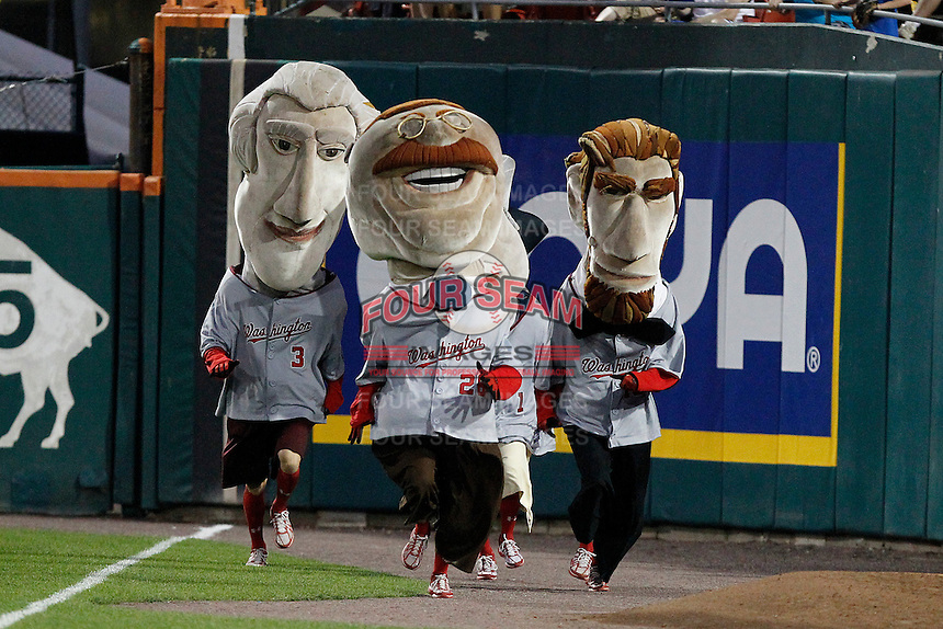 Washington Nationals mascots Thomas Jefferson, George Washington (hidden), Theodore Roosevelt, and Abe Lincoln participate in a race during a Buffalo Bisons game against the Syracuse Chiefs at Coca-Cola Field on September 1, 2011 in Buffalo, New York.  Syracuse defeated Buffalo 6-2.  (Mike Janes/Four Seam Images)