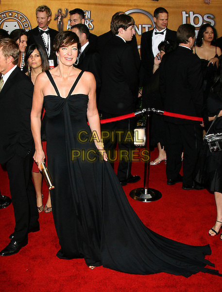 ALLISON JANNEY.12th Annual Screen Actors Guild Awards (SAG) held at the Shrine Auditorium, Los Angeles, California..January 29th, 2006.Photo: Zach Lipp/AdMedia/Capital Pictures.Ref: ZL/ADM.full length black dress .www.capitalpictures.com.sales@capitalpictures.com.© Capital Pictures.