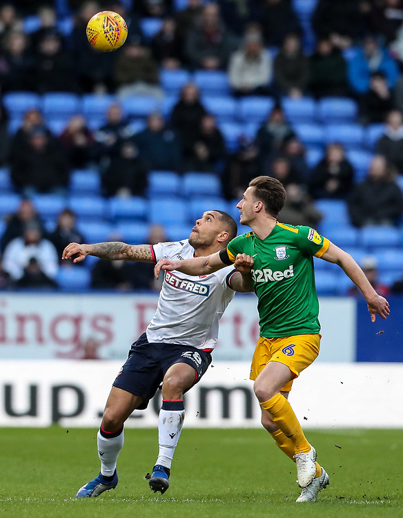 Bolton Wanderers' Josh Magennis competing with Preston North End's Ben Davies  <br /> <br /> Photographer Andrew Kearns/CameraSport<br /> <br /> The EFL Sky Bet Championship - Bolton Wanderers v Preston North End - Saturday 9th February 2019 - University of Bolton Stadium - Bolton<br /> <br /> World Copyright &copy; 2019 CameraSport. All rights reserved. 43 Linden Ave. Countesthorpe. Leicester. England. LE8 5PG - Tel: +44 (0) 116 277 4147 - admin@camerasport.com - www.camerasport.com