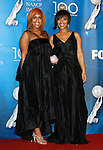 LOS ANGELES, CA. - February 12: Singers Tina Evette Atkins (R) and Erica Monique Atkins (L) of Mary Mary pose in the press room for the 40th NAACP Image Awards at the Shrine Auditorium on February 12, 2009 in Los Angeles, California.