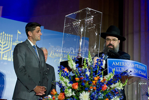 Rabbi Levi Shemtov, Executive Vice President of American Friends of Lubavitch (Chabad), right, presents the 2017 Lamplighter Award to the Speaker of the United States House of Representatives Paul D. Ryan (Republican of Wisconsin), left, at the Mellon Auditorium in Washington, DC on Tuesday, June 6, 2017.<br /> Credit: Ron Sachs /CNP/MediaPunch
