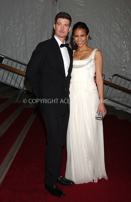 WWW.ACEPIXS.COM . . . . .....May 7, 2007. New York City.....Singer Robin Thicke and his wife, actress Paula Patton, leave the 'Poiret: King of Fashion' Costume Institute Gala at The Metropolitan Museum of Art. ..  ....Please byline: Kristin Callahan - ACEPIXS.COM..... *** ***..Ace Pictures, Inc:  ..Philip Vaughan (646) 769 0430..e-mail: info@acepixs.com..web: http://www.acepixs.com