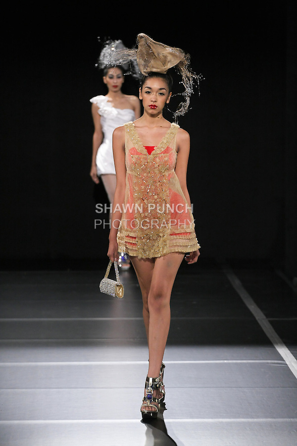 Model walks runway in a Sushma Patel Spring 2011 outfit, during Couture Fashion Week on September 10, 2010.