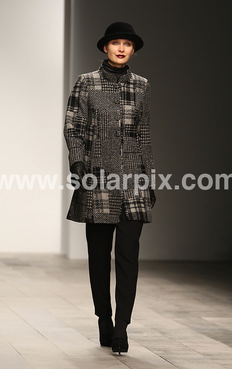 **ALL ROUND PICTURES FROM SOLARPIX.COM**                                             **WORLDWIDE SYNDICATION RIGHTS**                                                                                  Caption: The Caroline Charles catwalk show at London Fashion Week 2011, London, UK. 18 February 2011                                                                              This pic: Caroline Charles catwalk show                                                                                             JOB REF: 12822 MLW       DATE: 18_02_2011                                                           **MUST CREDIT SOLARPIX.COM OR DOUBLE FEE WILL BE CHARGED**                                                                      **MUST AGREE FEE BEFORE ONLINE USAGE**                               **CALL US ON: +34 952 811 768 or LOW RATE FROM UK 0844 617 7637**