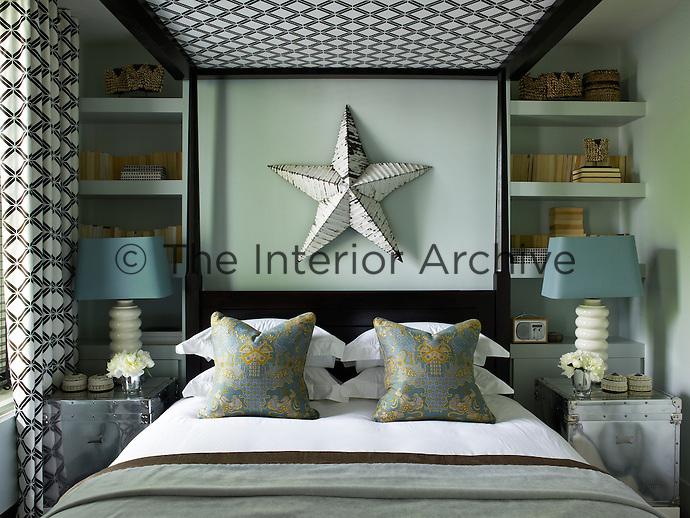 The bedroom has been arranged with elegant symmetry