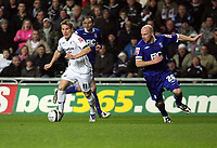 Pictured: Mark Gower (L) of Swansea followed by Lee Carlsey (R)<br />