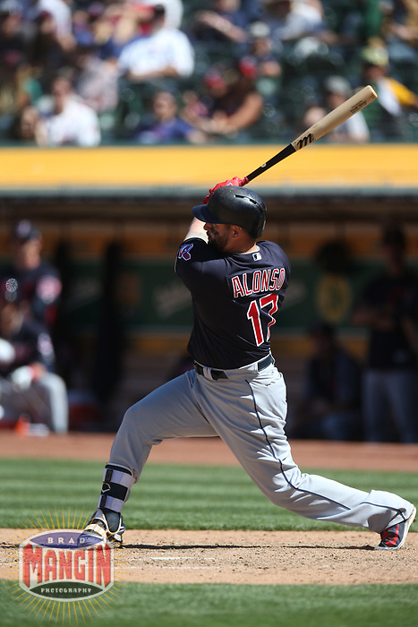 OAKLAND, CA - JUNE 30:  Yonder Alonso #17 of the Cleveland Indians bats against the Oakland Athletics during the game at the Oakland Coliseum on Saturday, June 30, 2018 in Oakland, California. (Photo by Brad Mangin)