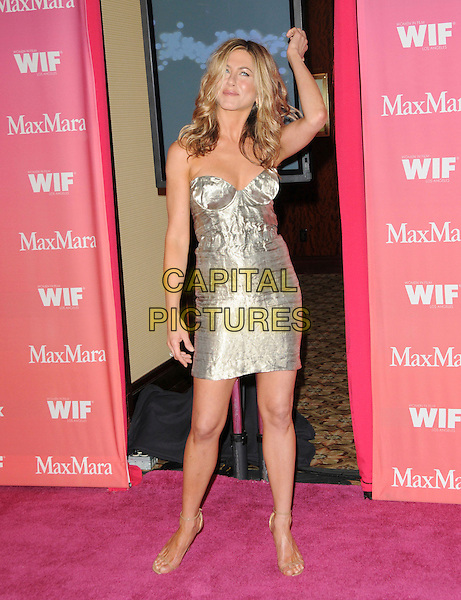 JENNIFER ANISTON .at The Women in Film 2009 Crystal .and Lucy Awards held at The Hyatt Regency Century Plaza in Century City, California, USA, June 12th 2009                                                                     .full length dress gold silver metallic shiny bustier cleavage strapless beige nude ankle strap sandals hand arm .CAP/DVS.©Debbie VanStory/RockinExposures/Capital Pictures