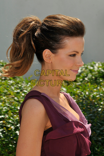 KATE BECKINSALE.attending the Jury Photocall at the Palais des Festivals during the 63rd Annual Cannes International Film Festival, Cannes, France, 12th May 2010..portrait headshot side profile hair up ponytail pink purple aubergine maroon  ruffle folded sleeveless .CAP/PL.©Phil Loftus/Capital Pictures.