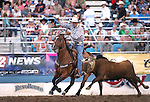 Monty Joe Petska competes in the team roping event at the Reno Rodeo in Reno, Nev., on Thursday, June 27, 2013.<br /> Photo by Cathleen Allison