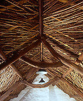 The underthatch is made of woven hazel and the timbers were found in a local wood