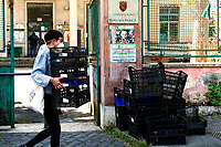 Rome May 8th 2020. Quarticciolo district. This morning in the Quarticciolo district, one of the poorest in Rome, volunteers of Red Lab, deliver empty fruit Boxes to the V City Hall to protest for the lack of help of the institutions, that haven't supported the less wealthy. In Rome, due to the economic crisis unleashed after the Coronavirus lockdown, many people have lost their jobs and can effort this period thanks to the donations and to the many associations and volunteers that deliver food every day.<br />  Photo Samantha Zucchi Insidefoto