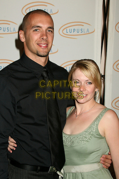"MARK WILKERSON & MELISSA JOAN HART.Lupus LA's ""Love, Light and Laughter"" Fundraiser 2007 at the Beverly Hills Hotel, Beverly Hills, California, USA..May 8th, 2007.half length green dress black shirt ti married husband wife couple.CAP/ADM/BP.©Byron Purvis/AdMedia/Capital Pictures"