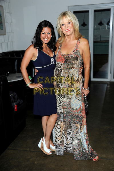 Haley Tammadon & Sherrie Hewson.Welch Morgan Locations launch party at The Collection, Brompton Road, London, England.June 28th 2012.full length blue dress hand on hip  zebra leopard print dress beige pink .CAP/CJ.©Chris Joseph/Capital Pictures.