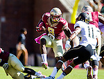 Karlos Williams leaps a fallen teammate to confront Wake Forest safety Anthony Wooding, Jr. as Florida State defeated Wake Forest 43-3 in an NCAA football game in Tallahassee, FL October 4, 2014.