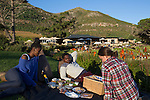 CAPE TOWN, SOUTH AFRICA MAY 18: People have a picnic at sunset at Cape Town Vineyards May 18, 2014 in Noordhoek outside Cape Town, South Africa. The city offers many different hiking trails and nature experiences close to the city center. (Photo by: Per-Anders Pettersson)