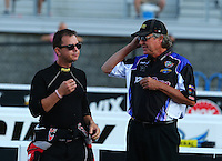 Sep 13, 2013; Charlotte, NC, USA; NHRA top fuel dragster driver Steve Torrence (left) with crew chief Richard Hogan during qualifying for the Carolina Nationals at zMax Dragway. Mandatory Credit: Mark J. Rebilas-