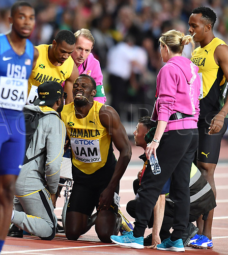 August 12th 2017, London Stadium, East London, England; IAAF World Championships, Day 9;  Jamaican athlete Usain Bolt grimaces after suffering an injury while competing in the men's 4 x 100 metre relay race at the IAAF World Championships in London, United Kingdom, 12 August 2017.