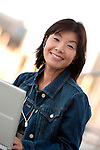 Asian woman working on laptop