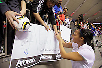 Sydney Leroux of the United States signs autographs for fans after the United States defeated Costa Rica in the CONCACAF Olympic Qualifying semifinal match at BC Place in Vancouver, B.C., Canada Friday Jan. 27, 2012. The United States won the match 3-0 to earn a berth in 2012 London Olympics.