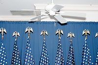 American flags with eagles at the top of the flagpole stand behind the podium after Democratic presidential candidate and former Vice President Joe Biden spoke at a campaign event at the Governor's Inn and Restaurant in Rochester, New Hampshire, on Wed., October 9, 2019.<br />  At this event, Biden said for the first time that he supported the impeachment inquiry against current President Donald Trump.