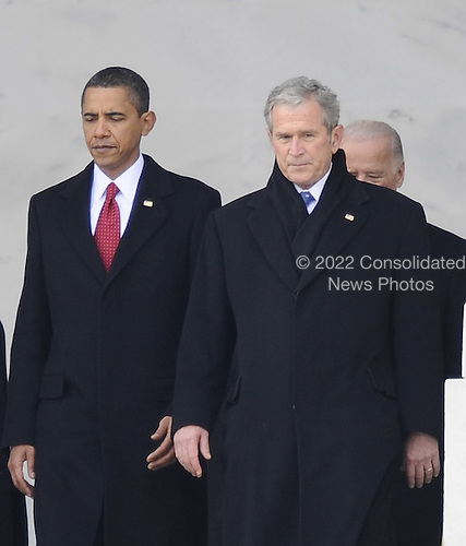 Washington, DC - January 20, 2009 -- Former United States President George W. Bush (R) is escorted by President Barack Obama as he departs from the U.S. Capitol after the swearing in of  Obama as the 44th President of the United States during the 56th Presidential Inauguration ceremony in Washington, D.C., USA 20 January 2009..Credit: Tannen Maury - Pool via CNP