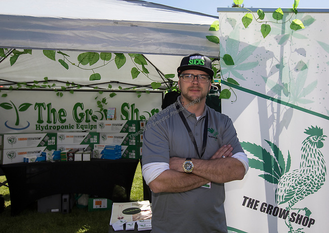 Brandon Heller in the Grow Shop booth during the inaugural Bud and Brew Music Festival in Wingfield Park in downtown Reno on Saturday, Sept. 23, 2017.