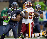 Seattle Running back Marshawn Lynch scores on a 20-yard touchdown against the against the Washington Redskins in the second quarter at  CenturyLink Field in Seattle, Washington on November 27, 2011. Lynch ran for 111 yards on 24 carries and scored one touchdown inSeattle Seahawks 17-23 loss to the Redskins. ©2011 Jim Bryant Photo. All Rights Reserved.