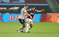 West Ham United's Josh Cullen and Charlton Athletic's Alfie Doughty<br /> <br /> Photographer Rob Newell/CameraSport<br /> <br /> Carabao Cup Second Round Northern Section - West Ham United v Charlton Athletic - Tuesday 15th September 2020 - London Stadium - London <br />  <br /> World Copyright © 2020 CameraSport. All rights reserved. 43 Linden Ave. Countesthorpe. Leicester. England. LE8 5PG - Tel: +44 (0) 116 277 4147 - admin@camerasport.com - www.camerasport.com