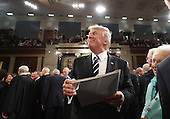 US President Donald J. Trump signs an autograph on his way out after delivering his first address to a joint session of Congress from the floor of the House of Representatives in Washington, DC, USA, 28 February 2017.  Traditionally the first address to a joint session of Congress by a newly-elected president is not referred to as a State of the Union.<br /> Credit: Jim LoScalzo / Pool via CNP