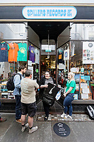 "Pictured: Fans queue outside Spillers Records.  Friday 13 September 2019<br /> Re: American Band Pixies have signed copies of their latest album ""Beneath The Eyrie"" at Spillers Records, the oldest record shop in the world, in Morgan Arcade, Cardiff, Wales, UK."