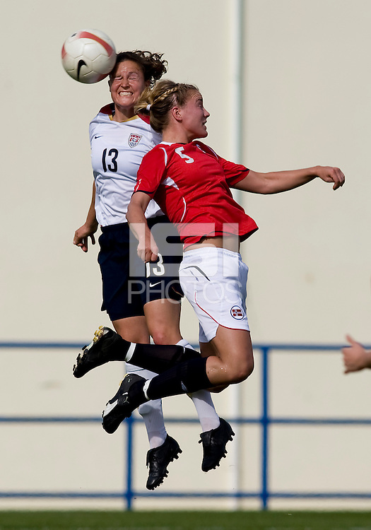 USWNT defender (13) Kendall Fletcher goes up for a header against Norwegian defender (5) Anneli Giske during the last group stage game in the Algarve Cup.  The USWNT defeated Norway, 1-0, in Ferreiras, Portugal. Photo by Brad Smith/ isiphotos.com