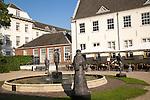 Statues sculptures in garden of historic Grand Hotel Karel V, Utrecht, Netherlands