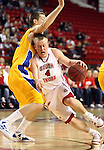 VERMILLION, SD - FEBRUARY 9: Louie Krogman #4 from the University of South Dakota looks to drive against Chad White #25 from South Dakota State in the second half of their game Thursday night at the DaktaDome in Vermillion, SD. (Photo by Dave Eggen/Inertia)
