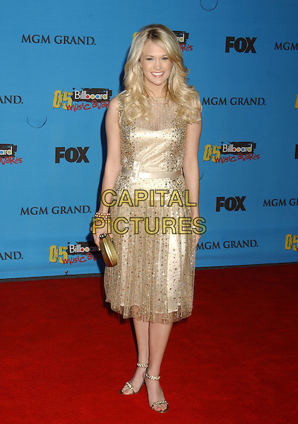 CARRIE UNDERWOOD.2005 Billboard Music Awards held at the MGM Grand Hotel & Casino, Las Vegas, Nevada..December 6th, 2005.Photo: Laura Farr/AdMedia/Capital Pictures.Ref: LF/ADM.full length sheer sequin gold dress clutch.www.capitalpictures.com.sales@capitalpictures.com.© Capital Pictures.