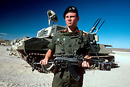 Fort Irwin, California - September 17, 1985. U.S. military personal stands in front of a tank during a training session at the National Training Center located in the Mojave Desert. Opened on October 16, 1980, this facility is the primary training area for the United States Military.