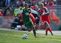 26 March 2011: Portland Timbers defender Jeremy Hall #17 and Toronto FC defender Mikael Yourassowsky #19 in action during an MLS game between the Portland Timbers and the Toronto FC at BMO Field in Toronto, Ontario Canada..Toronto FC won 2-0....