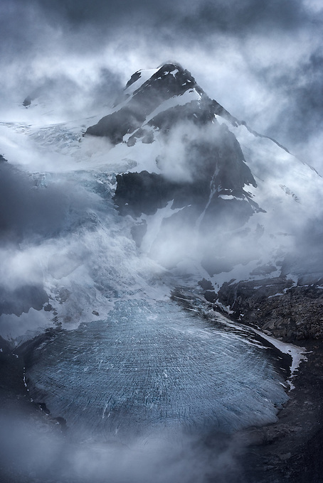 Mountain peak enveloped with incredible atmospheric conditions on the shoulder of a storm in the Coast Mountains.